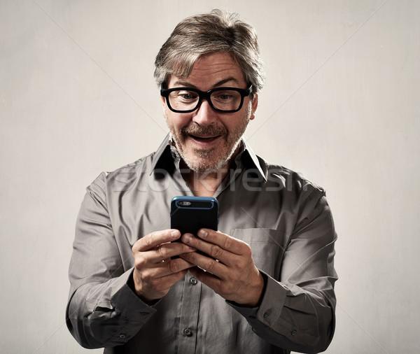 Man with cellphone Stock photo © Kurhan