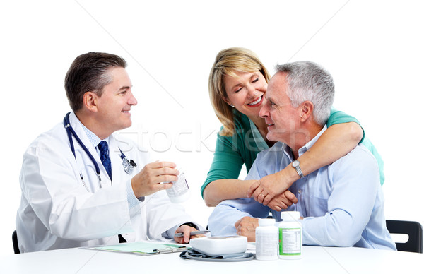Stock photo: Doctor and patient senior couple.