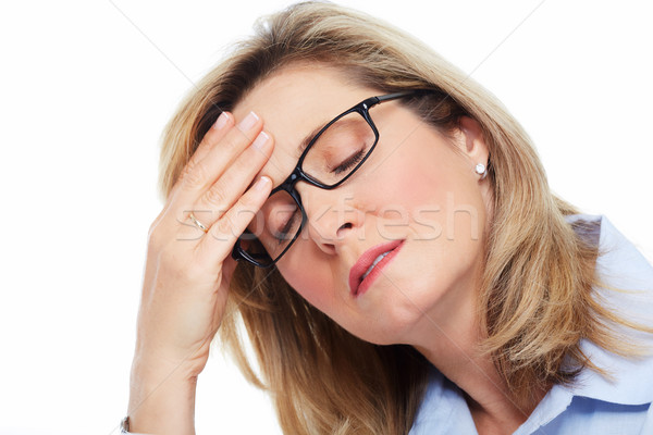 Woman having headache. Stock photo © Kurhan