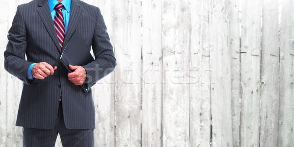 Businessman over wooden wall background. Stock photo © Kurhan