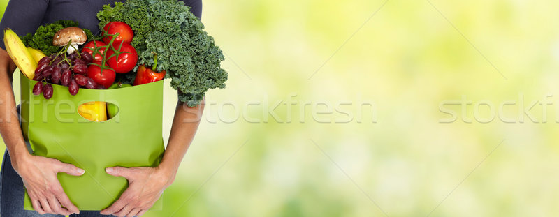 Woman hands with grocery bag of vegetables. Stock photo © Kurhan