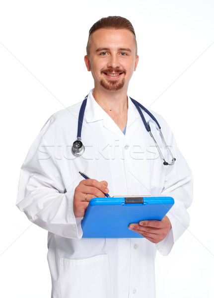 Young medical doctor with clipboard. Stock photo © Kurhan