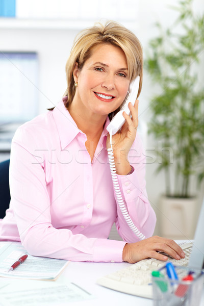 Business woman calling by phone. Stock photo © Kurhan