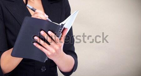 Woman writing in a diary book. Stock photo © Kurhan