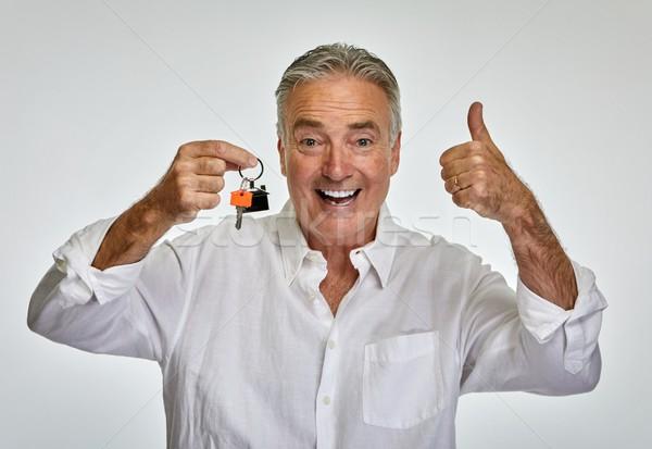 Senior man with house key. Stock photo © Kurhan