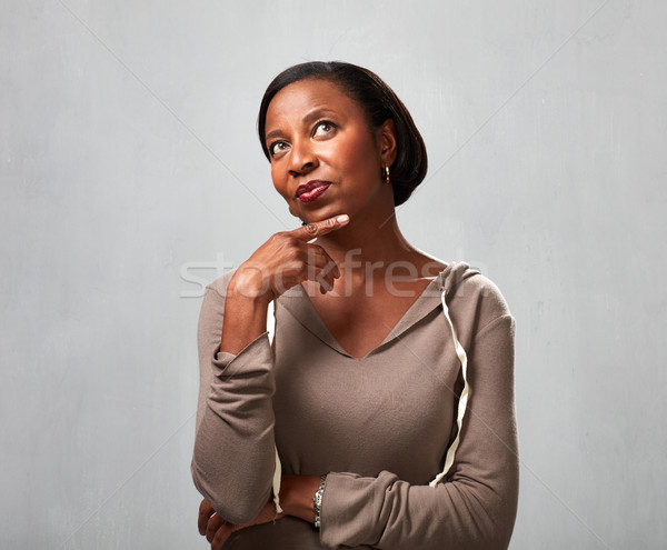 Thinking african woman Stock photo © Kurhan