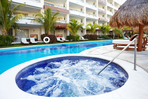 Jacuzzi and a swimming pool at caribbean resort. Stock photo © Kurhan
