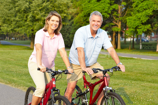seniors couple biking Stock photo © Kurhan