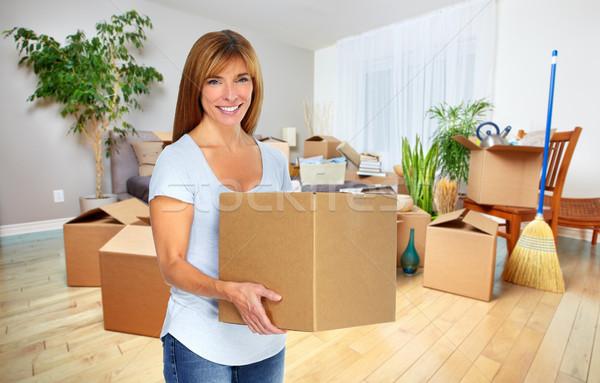 Woman with moving box. Stock photo © Kurhan