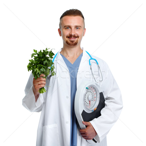 Doctor with body scales and parsley. Stock photo © Kurhan