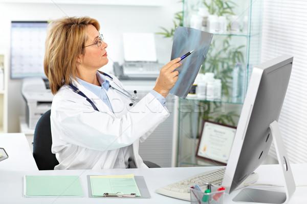 Mature doctor woman with a X-ray photograph. Stock photo © Kurhan