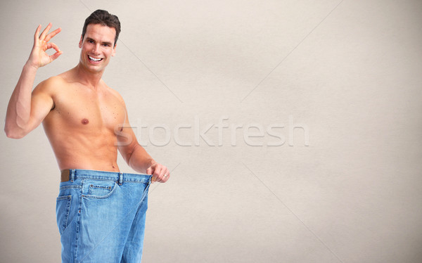 Slimming man with big size pants. Stock photo © Kurhan