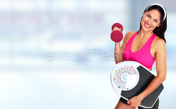 Woman with scales over blue background. Stock photo © Kurhan