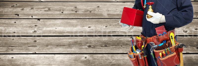 Plumber hands with tools. Stock photo © Kurhan
