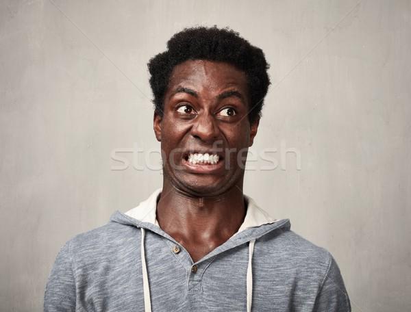 Adam siyah adam iğrenme yüz ifadeler portre Stok fotoğraf © Kurhan