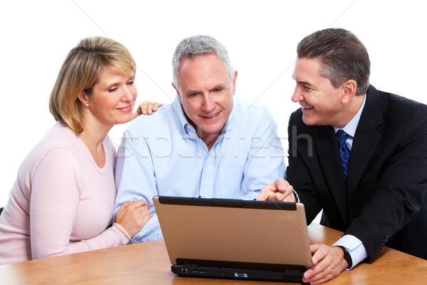 Senior couple with financial adviser. Stock photo © Kurhan