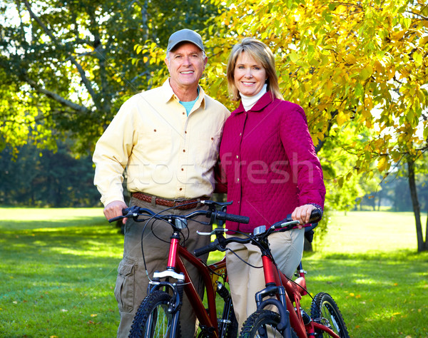 Casal de idosos ciclismo feliz parque fitness casal Foto stock © Kurhan