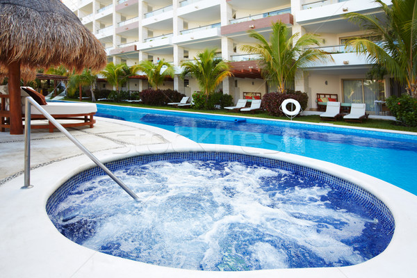 Jacuzzi and a swimming pool at caribbean resort. Stock photo © Kurhan