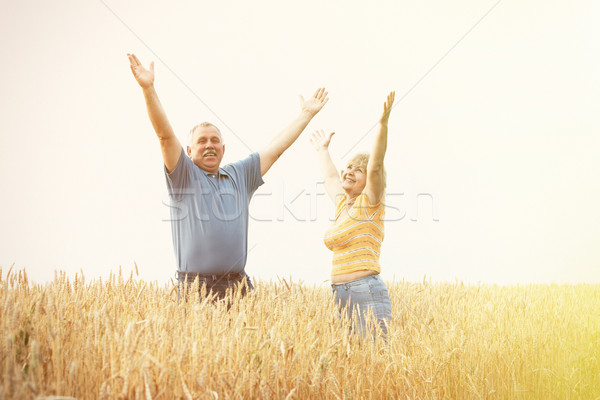 Old people over field background Stock photo © Kurhan