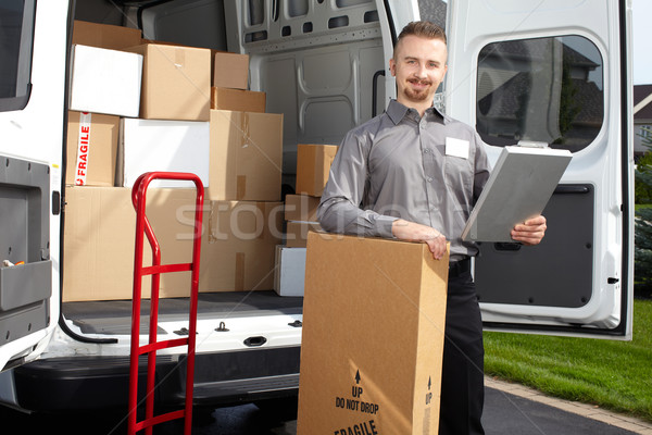 Young postman with parcel. Stock photo © Kurhan