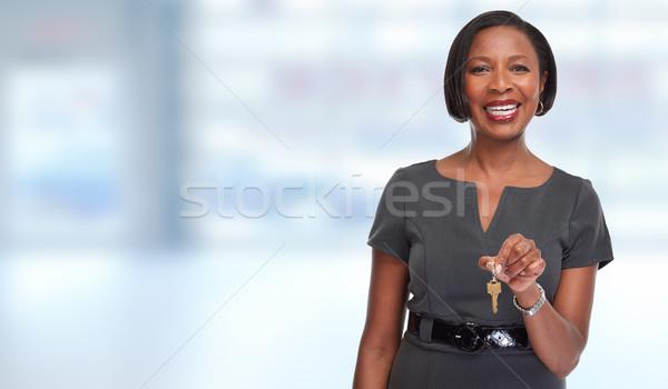 African-American realtor woman with key. Stock photo © Kurhan