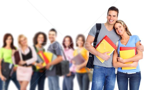 Diákok fiatal mosolyog izolált fehér lány Stock fotó © Kurhan