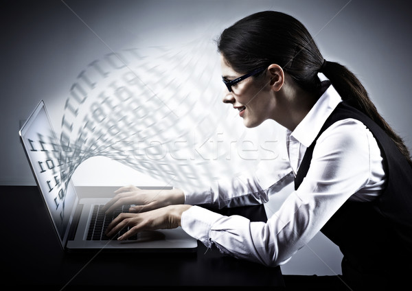 Woman working with laptop. Stock photo © Kurhan