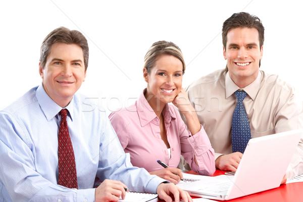 Stock fotó: üzletemberek · csapat · mosolyog · dolgozik · iroda · laptop