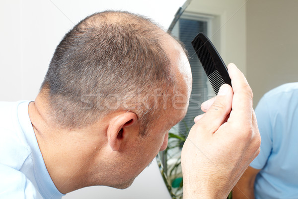 Man head with a comb. Stock photo © Kurhan