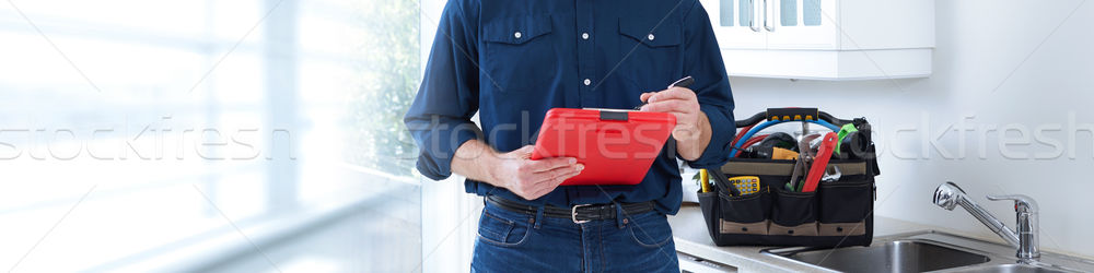 Plumber hands with clipboard. Stock photo © Kurhan