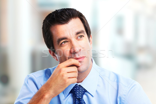 Thinking handsome businessman Stock photo © Kurhan