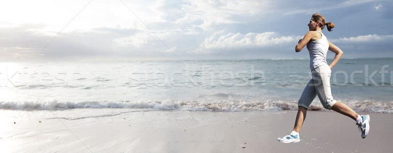 Woman running on the beach. Stock photo © Kurhan