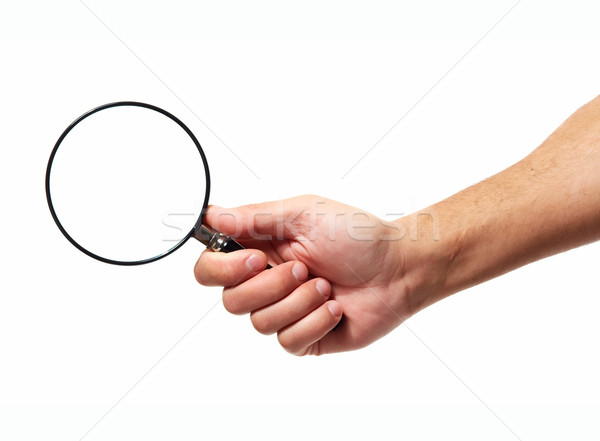 Hand with magnifying glass loupe. Stock photo © Kurhan