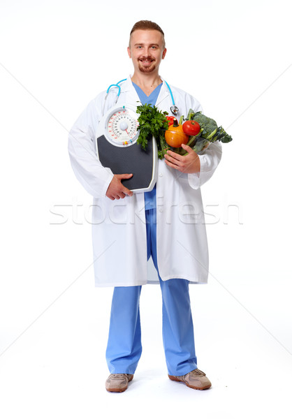 Doctor nutritionist  with scales and vegetables. Stock photo © Kurhan
