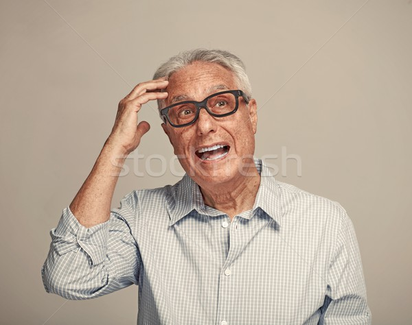 Thinking elderly man. Stock photo © Kurhan