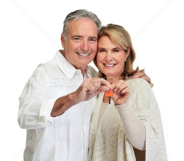Senior couple with house key. Stock photo © Kurhan