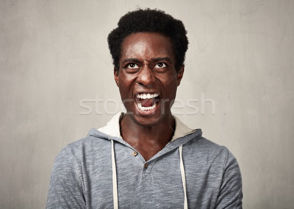 Angry black man. Stock photo © Kurhan
