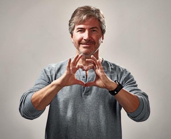 Paisible homme coeur souriant portrait gris Photo stock © Kurhan