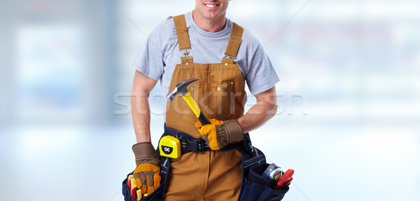 Construction worker with hammer Stock photo © Kurhan