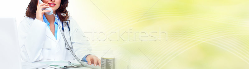 Doctor woman calling by phone Stock photo © Kurhan