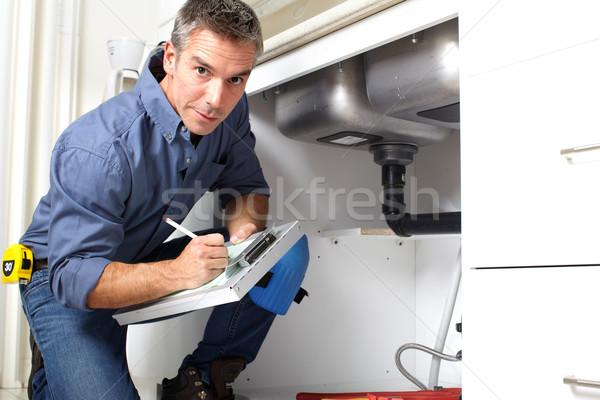 Encanador bonito sorridente cozinha reparação homem Foto stock © Kurhan