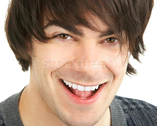 Hombre guapo sonriendo aislado blanco cara feliz Foto stock © Kurhan