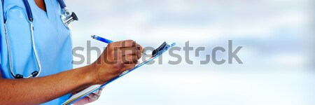 Eller siyah doktor kadın mavi el Stok fotoğraf © Kurhan