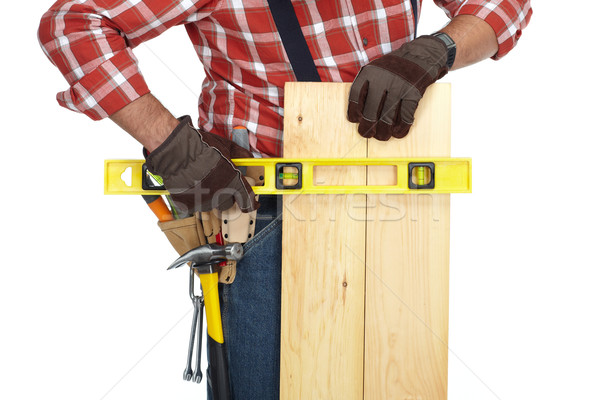 Handyman hands with wood plank. Stock photo © Kurhan
