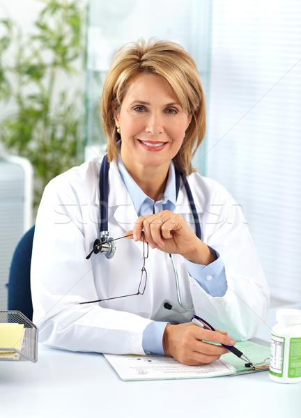 Mature doctor woman with pills. Stock photo © Kurhan