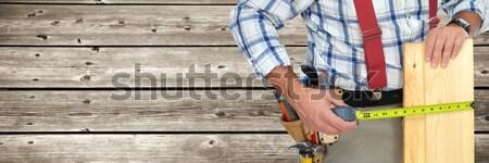 Hände Arbeitnehmer Holz Planke Herrscher grau Stock foto © Kurhan