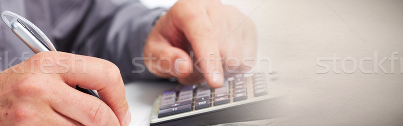 Accountant hands with calculator Stock photo © Kurhan