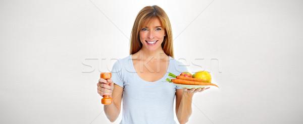 Hermosa dama alimentos saludable mujer Foto stock © Kurhan