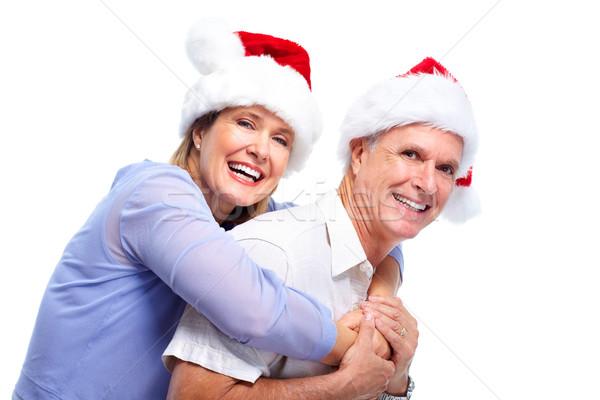Stock photo: Happy senior Christmas Santa couple.