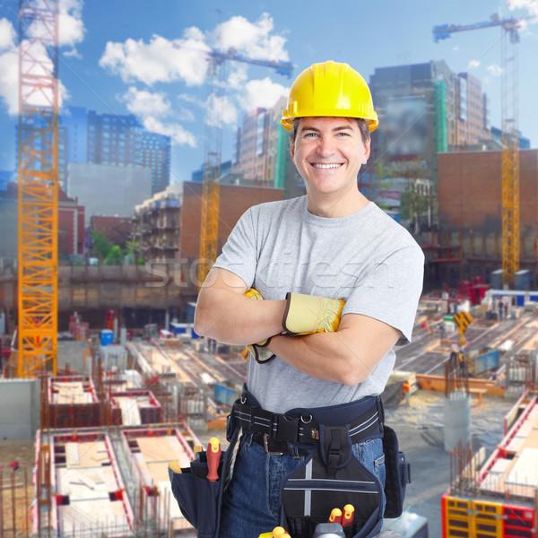 Pracownik budowlany człowiek uśmiechnięty architektury budynku tle Zdjęcia stock © Kurhan